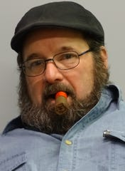 "Kevin McNeal, co-owner of The Paper Pipe: ""Step back, enjoy a nice cigar and enjoy your smoke."