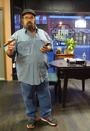 """Co-owner Kevin McNeal said The Paper Pipe is a place for patrons to relax and enjoy a cigar. Cigars were called """"paper pipes"""" in the 1920s, co-owner Susi McNeal explained."""