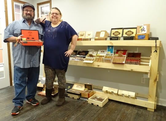 Kevin and Susi McNeal stand inside the humidor room at The Paper Pipe in downtown Bucyrus.