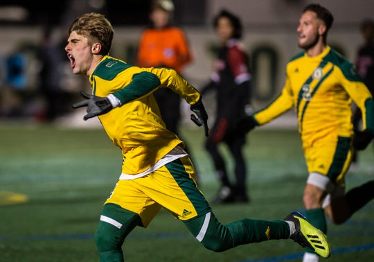 UVM's Garrett Lillie reacts after scoring off a header to tie the game 2-2, forcing overtime in the America East semifinal against Hartford at Virtue Field in Burlington on Wednesday, Nov. 13, 2019.