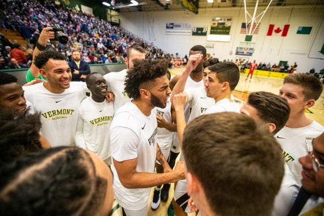 Vermont's Anthony Lamb hypes the Catamounts up before the men's basketball game between University of Vermont and Boston University at Patrick Gymnasium in Burlington on Wednesday November 13 2019.