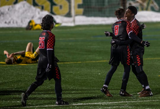 Hartford men's soccer celebrates their sudden-death overtime goal to win the America East semifinal, 3-1, against UVM at Virtue Field in Burlington on Wednesday, Nov. 13, 2019.