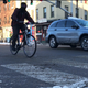 A cyclist shares the road on Winooski Avenue at Pearl Street on Nov. 13, 2019. This part of Winooski Avenue is generally considered unsafe for bicycle traffic.