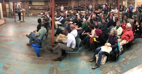 Public meeting on cars and bikes: More than 100 people gather at the Old North End Community Center in Burlington to hear a presentation on proposed safety upgrades to Winooski Avenue. Later in the evening, participants debated the possible loss of parking spaces.