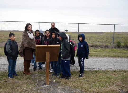 Nueces Judge Barbara Canales walks with children, Wednesday, Nov. 13, 2019. Canales read the story while walking with kids.
