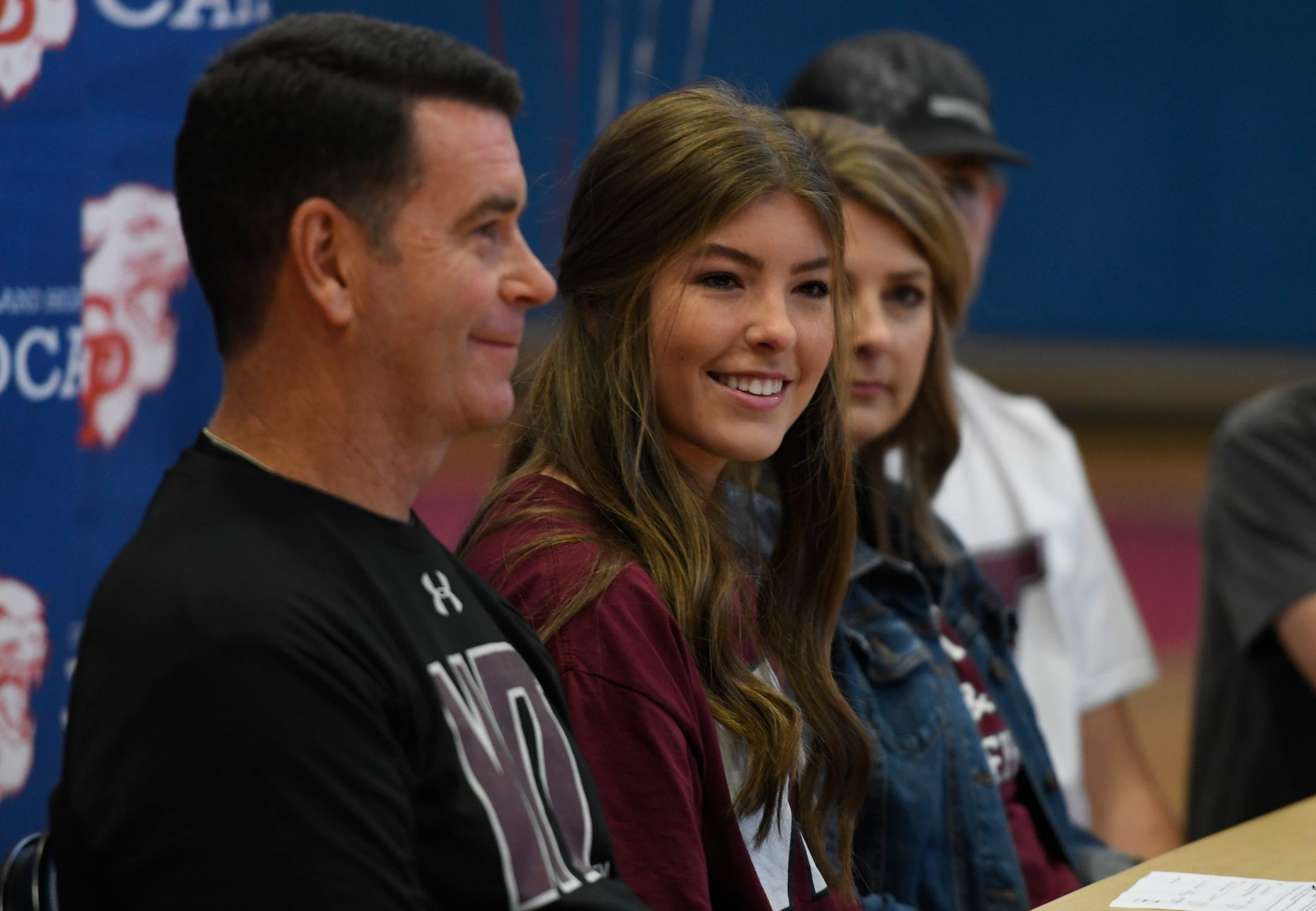 Camryn Jones, center, sits during signing day, Wednesday, Nov. 13, 2019, at Gregory-Portland High School. Jones committed to West Texas A&M University.