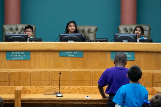 Windsor Park Elementary third grade students portraying city council members hear public comment during their mock City Council meeting debating if the should the city enhance and develop North Beach on Thursday, Nov. 14, 2019.