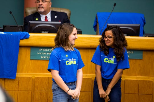 Laynie Houser, left, 12, and Hilari De Leon,11, attend a City Council meeting on Tuesday, November 12, 2019 to encourage people to register to donate bone marrow. Both girls are recipients of lifesaving bone marrow transplants from individuals who signed up on Be the Match. The month of November is National Marrow Awareness Month.