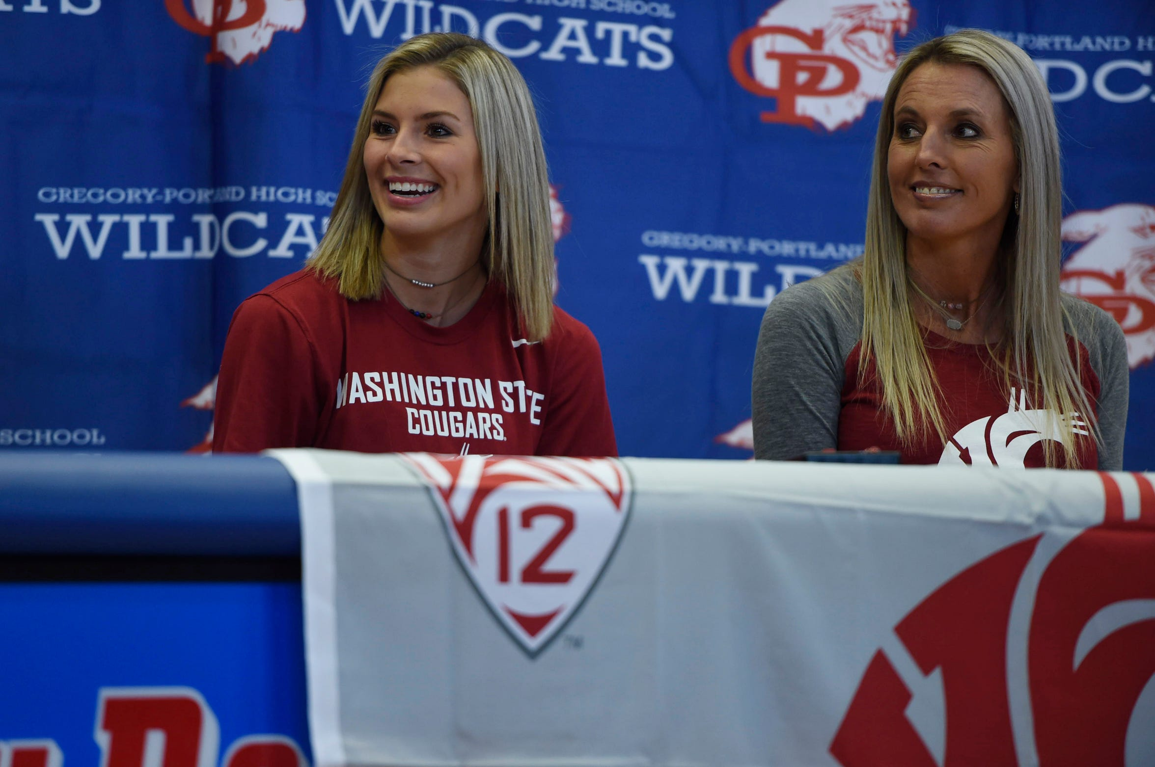 Colby Gonzales. left, smiles during her signing day next to her mother Sharla Gonzales, right,  Wednesday, Nov. 13, 2019, at Gregory-Portland High School. Gonzales has 1,847 career digs.