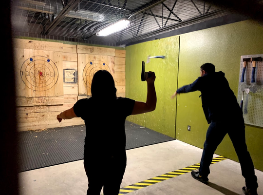 A couple participates in axe throwing at Tac-TX Entertainment on Friday, Nov. 8, 2019.