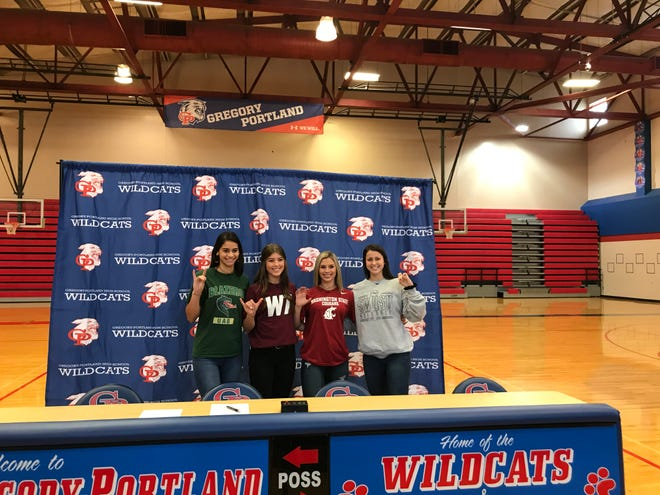 Gregory-Portland seniors Chloe Rodriguez, from left, Camryn Jones, Colby Gonzalez and Samantha Kuzma pose for pictures after their signing ceremony on Wednesday, Nov. 14, 2019 at the Gregory-Portland High School Gymansium.