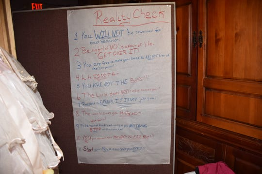 "A photo showing a list a rules taken inside the Breeze home. ""Life is not fair,"" it reads. ""You are not the boss."""