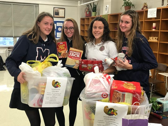 Project Paul Thanksgiving food drive. Pictured with some of the donations that will be given, are: Maggie Burke of Westfield, Kayla DeAngelis of Basking Ridge, Maggie Barr of North Brunswick and Jaclyn Dencker of Westfield.