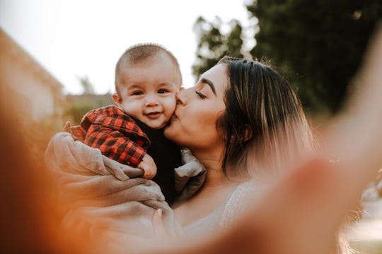 Women Aware in New Brunswick assists victims of domestic violence, serving more than 2,000 women, men and children every year. Pictured are a mother and her child.
