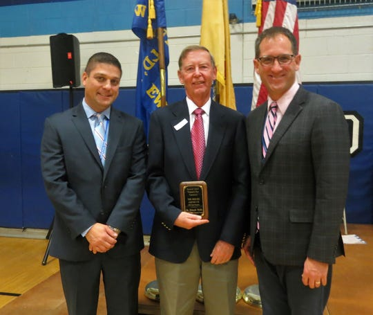 "During its annual Veterans Day assembly on Monday, Nov. 11, Roosevelt Intermediate School honored Helmuth Meditz, who served five years in the U.S. Army National Guard, with the ""Heroes Among Us"" award. Meditz is pictured here with Roosevelt principal Brian Gechtman (left) and teacher/assembly coordinator Brian Vieth."
