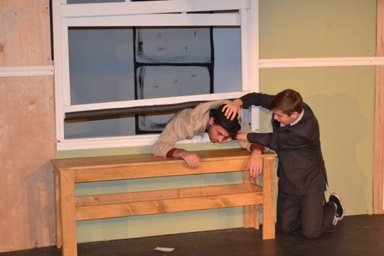 "(Right to left) Richard Willey (played by Robert Oakes) checks the pulse of the body (played by Nick Najarian) in Old Bridge High School's fall comedy, ""Out of Order."""