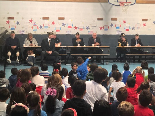 Parker Elementary School students honoring Veterans Day.
