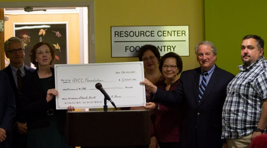 Participating in a check presentation ceremony at the Raritan Valley Community College Campus Resource Center, at an event celebrating the life of Jennifer Biniek, are, from left, Mike Marion, executive director, RVCC Foundation; Deborah Preston, Provost and vice president for Academic Affairs, RVCC; Lisa Erickson (Jennifer Biniek's sister); Janice Kaufman (Jennifer Biniek's mom); Michael Goldberg, trustee, J.S. Henderson Scholarship Fund; and Brian Biniek (Jennifer Biniek's husband).