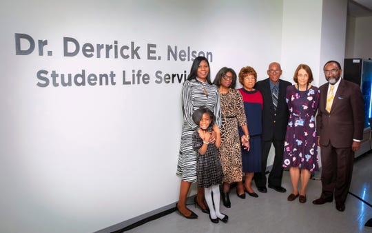 Hackensack Meridian School of Medicine in South Orange unveiled Dr. Derrick Nelson Student Life Services on Thursday in honor of the Westfield High School principal who died April 8 in an affiliated hospital. Pictured from left to right are Sheronda Braker, Nelson's fianceé; Morgan K. Nelson, Nelson's daughter; Sherry Gardner-Braker, fiancee's mother; Juanita Nelson,  Nelson's mother; Willie Nelson,  Nelson's father; Dr. Bonita Stanton, founding dean, Hackensack Meridian School of Medicine at Seton Hall University; and the Honorable Marvin T. Braker; fiancee's father.