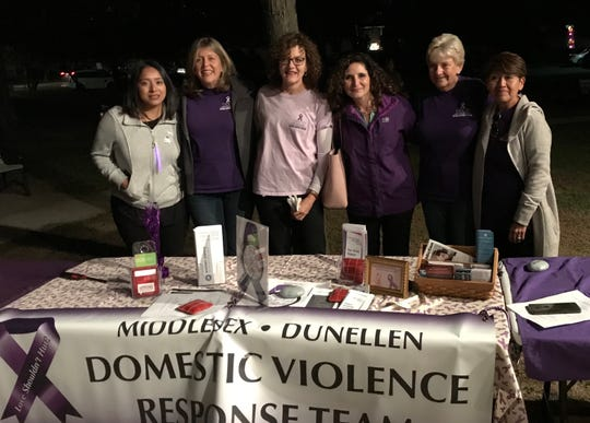 Women Aware's Domestic Violence Response Team at the 8th Annual Candlelight Vigil at Washington Park in Dunellen, on Thursday, Oct. 10. The event was hosted by the Middlesex-Dunellen Domestic Violence Response Team and Women Aware to pay tribute to victims of domestic violence and to honor survivors who are moving beyond abuse.