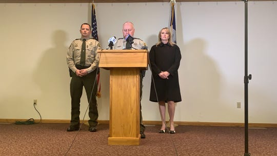 Story County Sheriff Paul Fitzgerald is flanked by Chief Deputy Nick Lennie and County Attorney Jessica Reynolds during a press conference.
