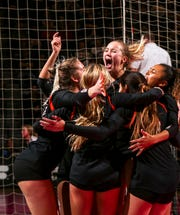 West Des Moines Valley players celebrate the match point of their Class 5A semifinal match of the girls high school state volleyball tournament at the U.S. Cellular Center in Cedar Rapids on Thursday, Nov. 14, 2019. (Andy Abeyta/The Gazette)