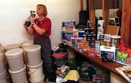 From September 1999: For the family of Debbie Black of West Des Moines, there's no need to panic about preparedness for potential Y2K problems. The Blacks try to be prepared for any event, with supplies on hand. Here, she demonstrates a hand-operated grain mill, surrounded by staples such as wheat, powdered milk, sugar and rice.