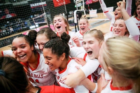 Cedar Falls players celebrate their win during a 5A semifinal between Cedar Falls and Ankeny at the IGHSAU State Volleyball Tournament at the U.S. Cellular Center in Cedar Rapids on Thursday, Nov. 14, 2019. Cedar Falls won the match, 21-25, 25-18, 25-16, 25-15.