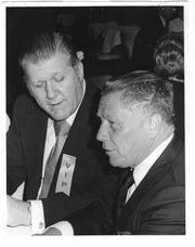 Philadelphia Teamsters official Frank Sheeran, left, speaks with Teamsters boss Jimmy Hoffa, right, in this undated photograph.