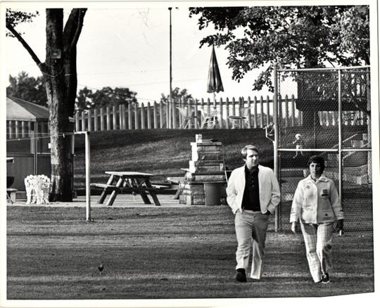James P. Hoffa and his sister Barbara Crancer walk the grounds of Jimmy Hoffa's home shortly after his disappearance in 1975.