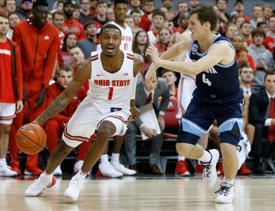 Ohio State's Luther Muhammad drives the baseline past Villanova's Chris Arcidiacono during the second half.