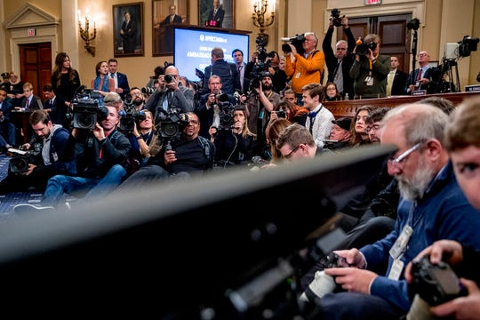Members of the media record as career Foreign Service officer George Kent and top U.S. diplomat in Ukraine William Taylor appear before the House Intelligence Committee on Capitol Hill in Washington, Wednesday, Nov. 13, 2019.