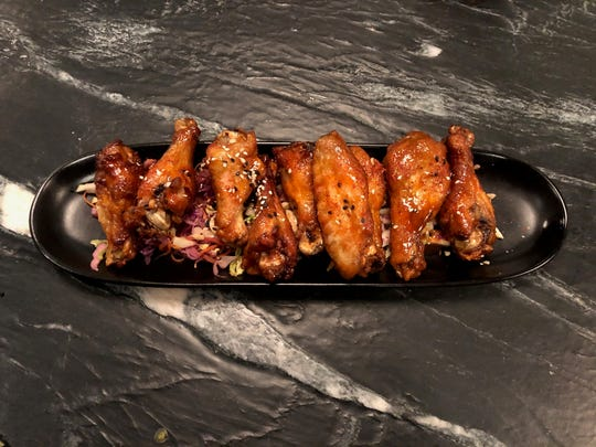 The chicken wings at Smith & Co. are sweetened with Faygo Red Pop.