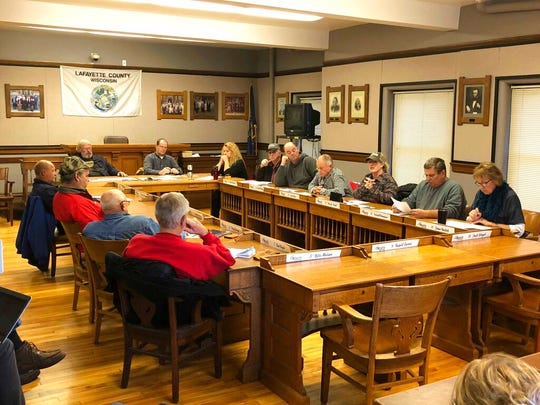 In this Tuesday, Nov. 12, 2019 photo, members of a Lafayette County committee discuss a resolution during a meeting in Darlington, Wis., to discipline county officials who speak about water quality studies without permission.