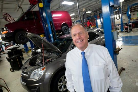 General Manager Walt Tutak stands inside the Matthew Hargreaves Chevrolet dealership service department in Royal Oak Thursday.