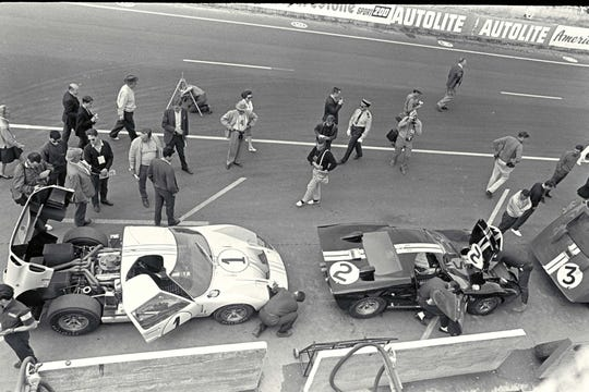 The winning #2 Ford GT40, right, and second-place #1 car, left, in the Le Mans pits prior to the 1966 race.