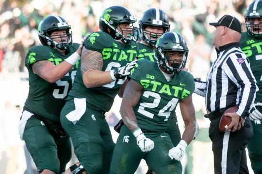 Michigan State running back Elijah Collins (24) rushed for 170 yards and two touchdowns Saturday against Illinois, getting help from an offensive line starting two true freshmen.