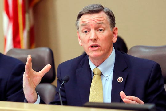 FILE - In this Dec. 2013, file photo, U.S. Rep. Paul Gosar, R-Ariz., speaks during a Congressional field hearing on the Affordable Care Act in Apache Junction, Ariz. Gosar appears to be signaling support for a conspiracy theory that Jeffrey Epstein did not kill himself while awaiting trial on sex trafficking charges.