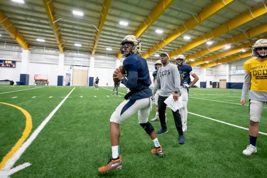 Quarterback Ahlon Mitchell prepares to throw a pass during football practice in the Detroit Country Day indoor facility on Wednesday.