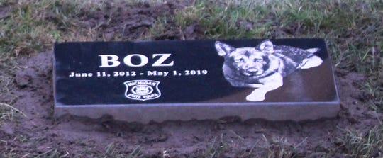 A granite plaque honors Boz, who tracked weapons and suspects in high-crime areas with his partner of State Trooper Matt Unterbrink.