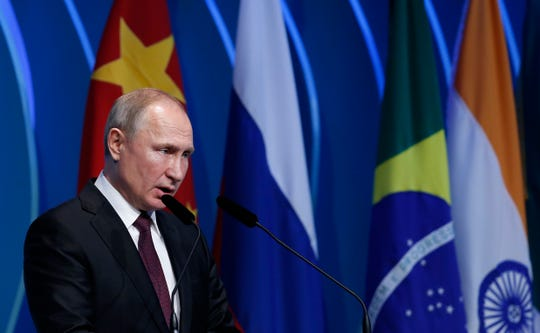 Russia's President Vladimir Putin speaks during the BRICS Business Council prior the 11th edition of the BRICS Summit, in Brasilia, Brazil, Wednesday, Nov. 13, 2019. The BRICS Summit gathers the group of countries formed by Brazil, Russia, India, China and South Africa, which will take place in the 13th and 14th of this month.