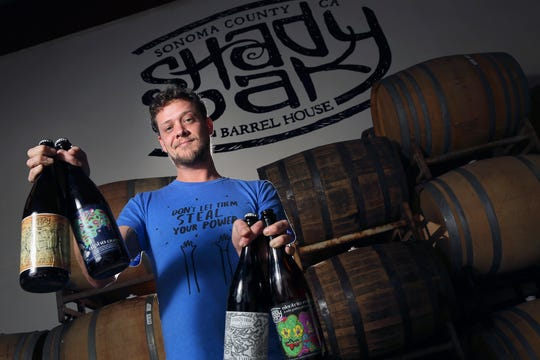 In this Feb. 29, 2016 photo, Steve Doty, owner of Shady Oak Barrel House, poses for photos in Santa Rosa, Calif.