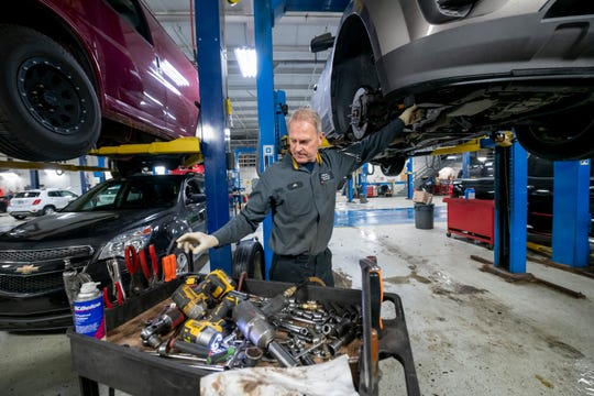 Heavy technician Al Nadolny replaces the timing chain on a Chevy Equinox at the Matthew Hargreaves Chevrolet dealership in Royal Oak, Thursday, November 14, 2019.
