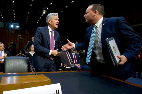 Federal Reserve Board Chair Jerome Powell shake hands with Chairman of the Congress Joint Economic Committee Sen. Mike Lee, R-Utah, during the hearing on the economic outlook, on Capitol Hill in Washington, on Wednesday, Nov. 13, 2019.