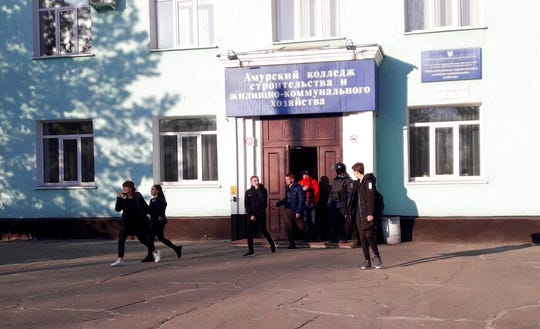 In this photo provided by Vera Zaderko, students leave a college after a shooting in Blagoveshchensk, Russia, Thursday, Nov. 14, 2019.
