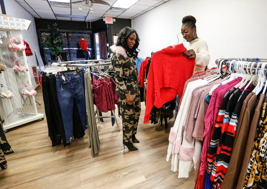 Sisters Myisha and Syeda Green get Myisha's store, Mai's Closet Couture, ready to open up for business Nov. 13, 2019, at 35 N. Main St. in Fond du Lac, Wis.