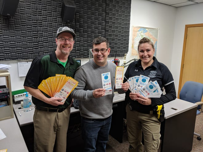 Brad Parker from Papa Johns Pizza, Keith Heisler from local radio stations and Fond du Lac police officer Kristina Meilahn hold tickets that will be issued by police for doing the right thing.
