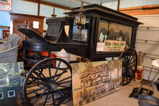 In addition to the thousands of artifacts inside the museum home, many more, like this horse-drawn hearse, are on display in the museum barn.