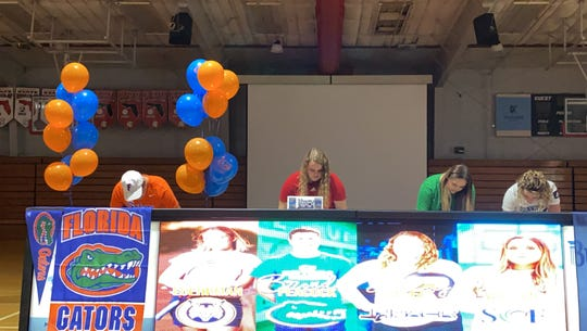 Evangelical Christian School seniors (from left) Brendan Peacock, Ashley Owlett, Jadyn Wallen and Alexandra Luehrman sign National Letters if Intent to continue their athletic careers in college on Thursday.
