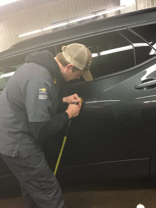 Luxemburg-Casco High School senior Austin Tank works on a car as part of his youth apprenticeship at Gandrud Chevrolet.